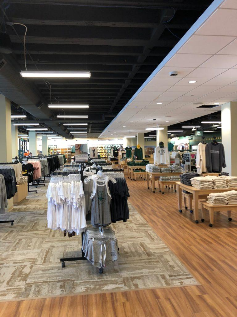 A newly-designed and renovated university bookstore opened Monday after months of operating out of West Hall and the Peter White Lounge. The bookstore is now located in the new university center and its design attempts to streamline customers' in-store experience. / Photo by Nate Bellville