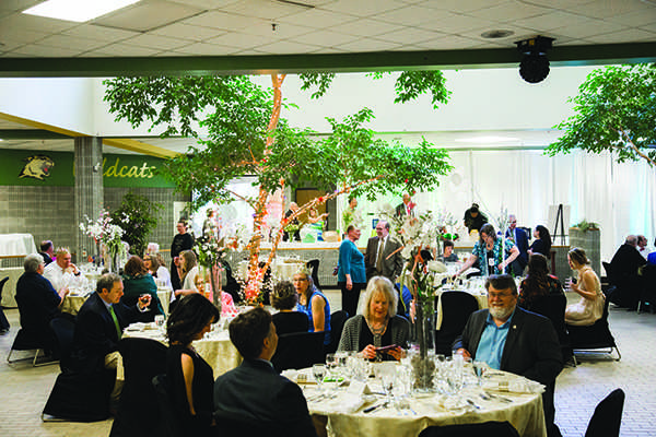 Guests of the 2017 Main Event, a Narnia-themed dinner, sit in a decked-out Jacobetti Complex that took participants through the wardrobe. The 2019 dinner, happening Friday, is circus themed. / Photo by NW Photo Archives