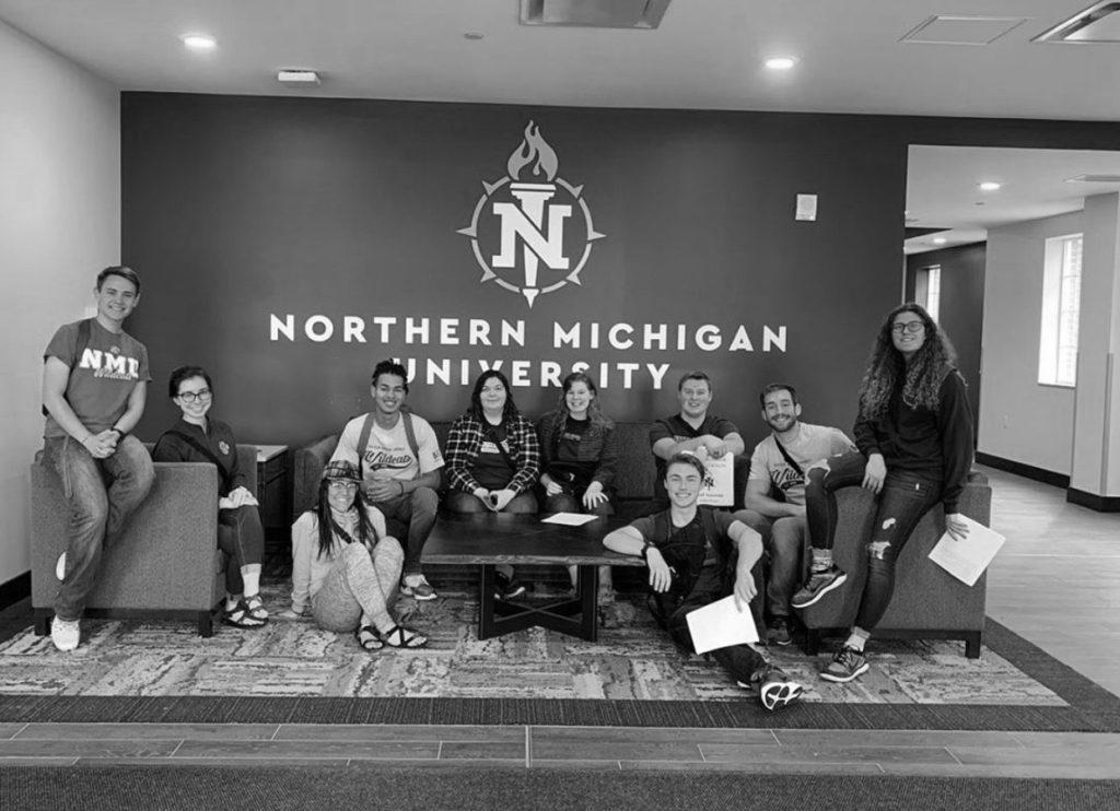 The+2019+Orientation+staff+posing+for+a+group+photo+in+the+lobby+of+the+Woods+residence+building.+Photo+courtesy+of+NMU+Housing+Instagram.