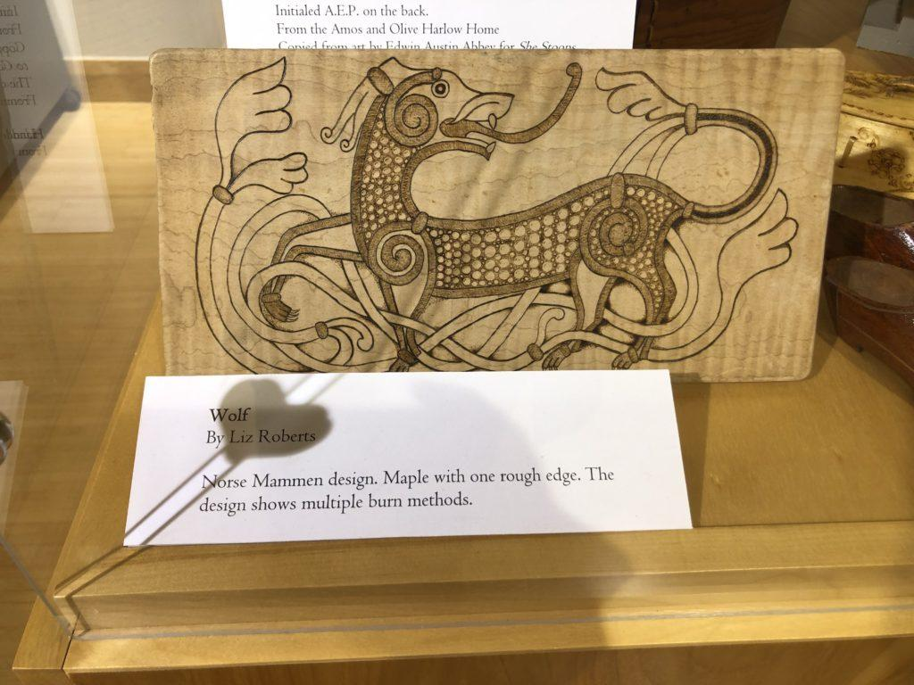 """BURNING WOOD —  Marquette Regional History Center showcases Liz Roberts  wood burning piece, """"Wolf,"""" a Norse Mammen design made of maple, an example Roberts will use in her upcoming workshop on Sept. 14. Jackie Jafetson/NW"""