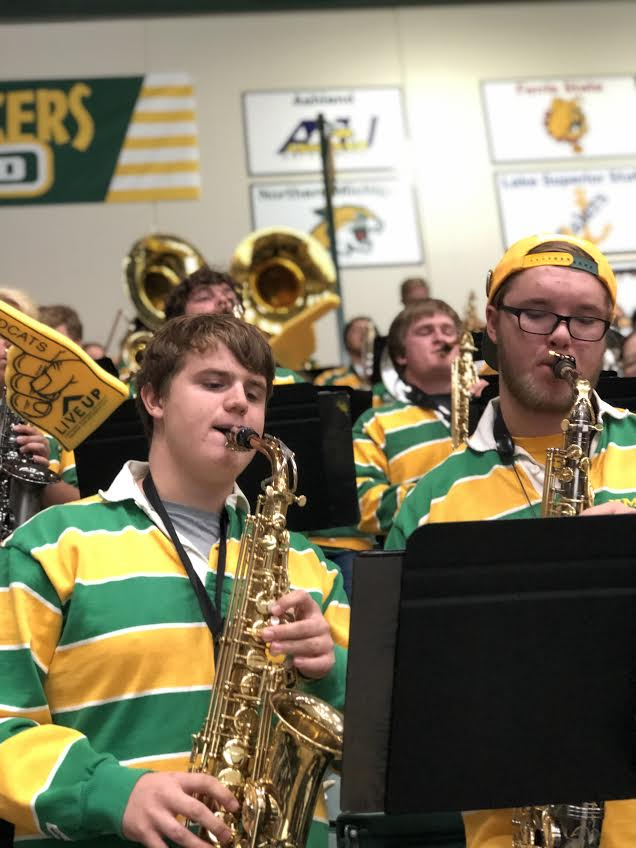 SMELLS+LIKE+TEAM+SPIRIT%E2%80%94The+rebranded+Twisted+Whiskers+band+peps+up+the+audience+at+NMU%E2%80%99s+hockey+game+on+Saturday%2C+Oct.+12+against+the+Michigan+State+University+Spartans.