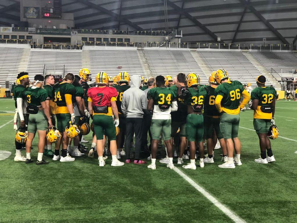 RECRUITING+RUT%E2%80%94NMU+Football+Head+Coach+Kyle+Nystrom+meets+with+his+team+after+an+October+practice.+All+NMU+sports+are+left+without+their+coveted+spring+recruiting+seasons+due+to+COVID-19.+Travis+Nelson%2FNW