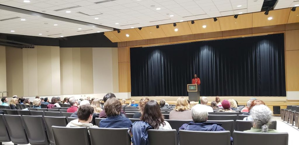 """CAPTIVATED AUDIENCE—Jericho Brown takes the podium in Jamrich to read from his new book of poems, """"The Tradition."""""""