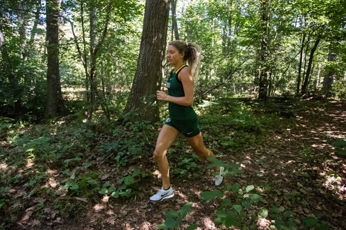 RUNNING FOR BRAGGING RIGHTS—The Wildcats will host Michigan Tech for the cross country U.P. championship. The teams faced off in a scrimmage in the preseason. Photo courtesy of NMU Athletics.