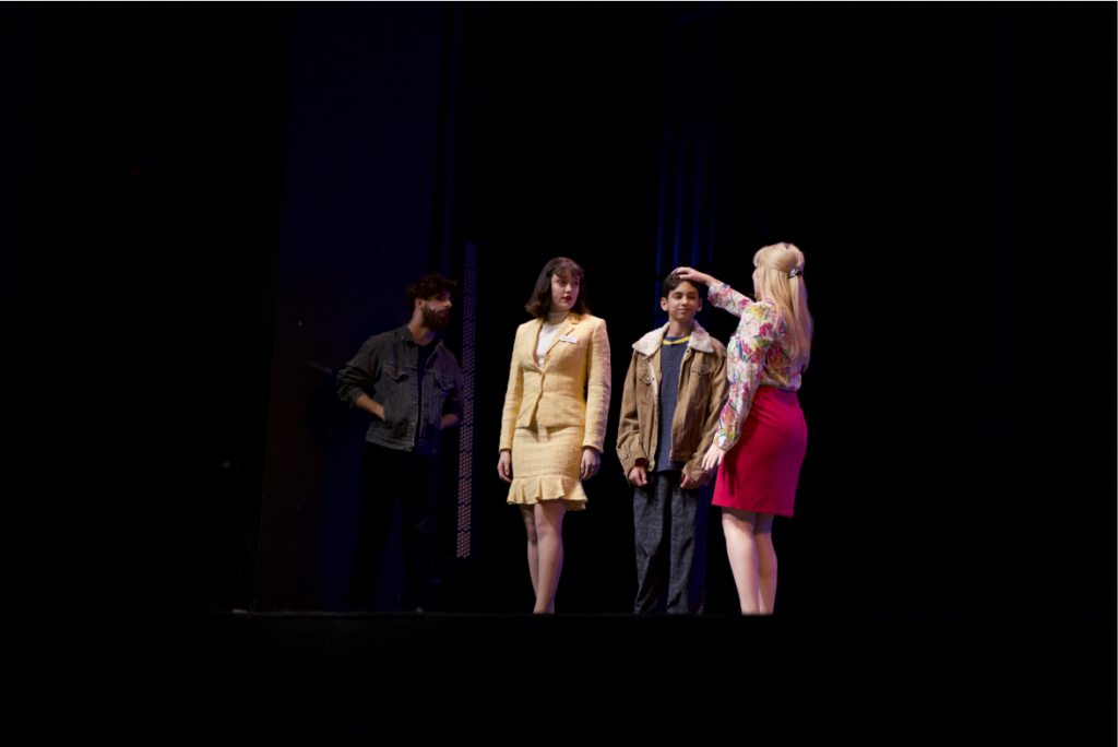 """AN AWKWARD ENCOUNTER—Jerry, played by NMU alumnus Brady Skewis (middle) talks with his ex-wife Pam, son Nathan and part-time lover Estelle, during the second act of """"Full Monty."""""""