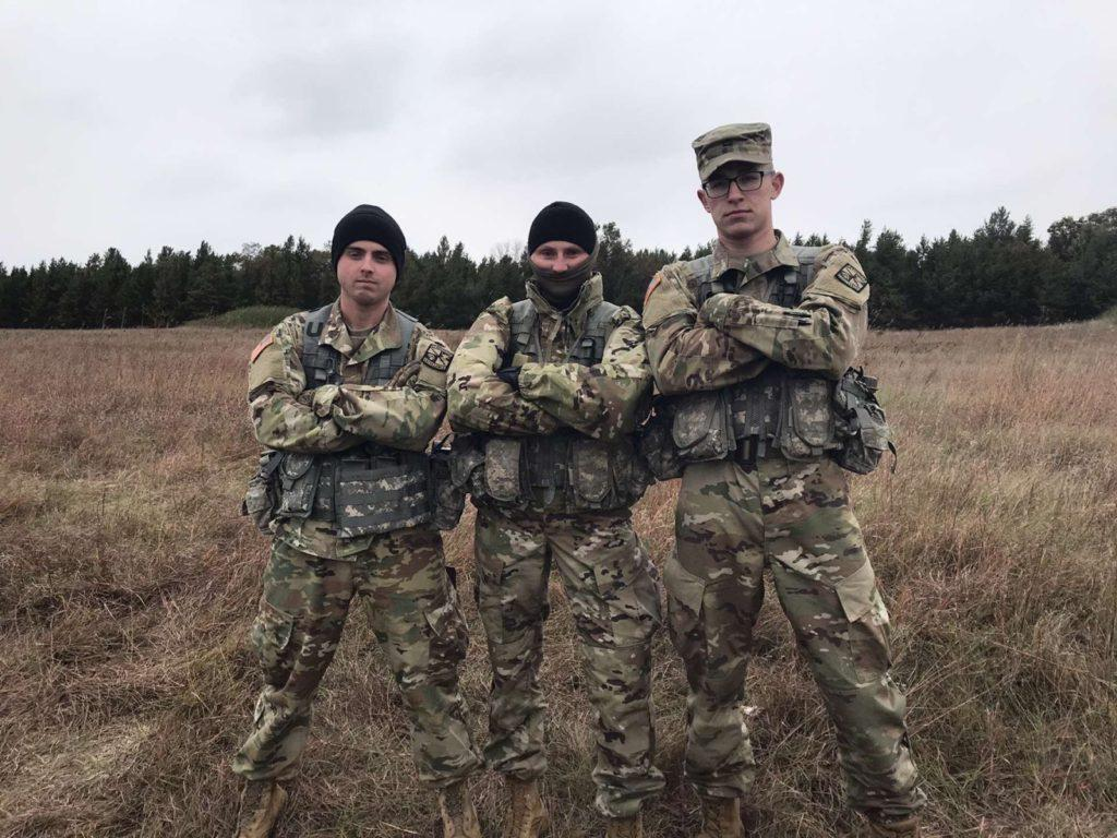 RUCKING TO VICTORY—ROTC cadets Anden Armbruster(left) from the not placed nine-man team, Ally Wasinksi from the 2nd place five-man team and Quinten DeMyer also on the nine-man team compete in the weekend long event. Photo courtesy of cadet Derek Hentkowski