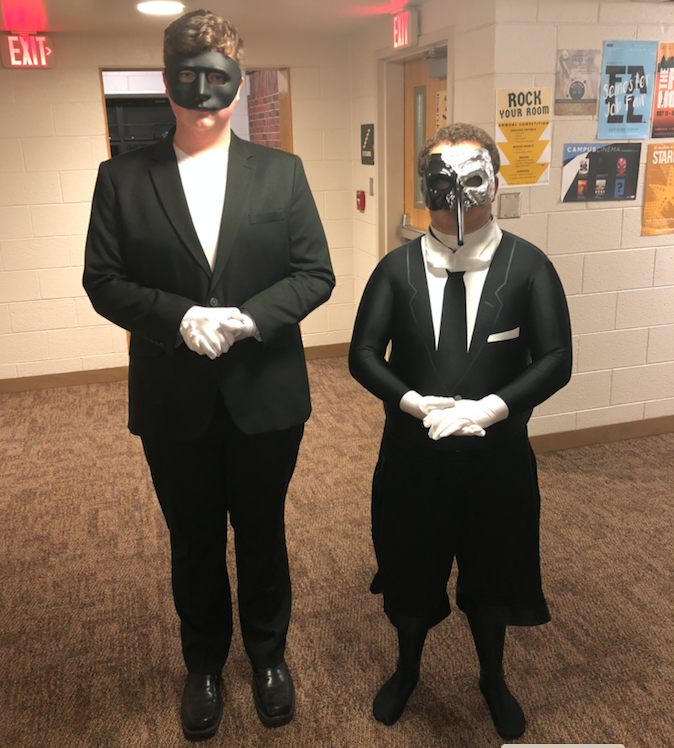 SERVING SPOOKY LOOKS—Sophomores Wyatt Sormunen (left) and Dylan Neelis introduced a Narnia themed Murder Mystery event to Mager Hall to celebrate the thrills of Halloween.  Josh La Gorio
