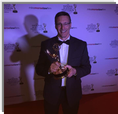 AWARD FOR EXCELLENCE—Dwight Brady holds an Emmy he earned for his contribution to a Michigan television series.