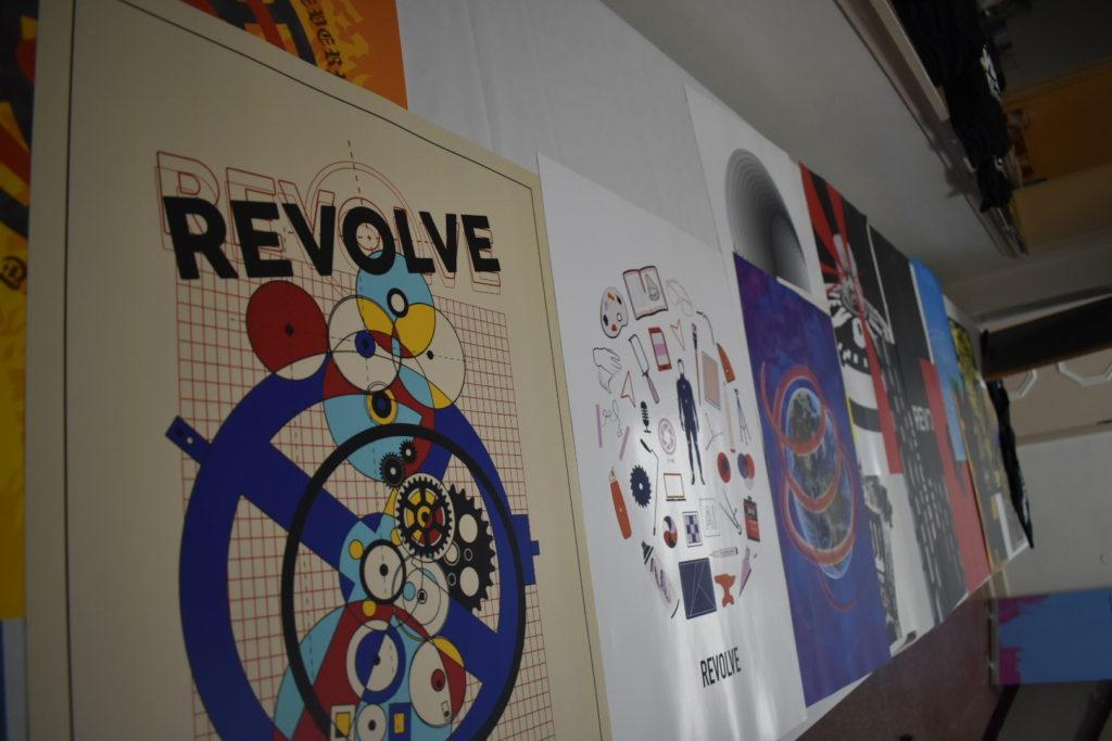 """POSTERS FOR SALE—Graphic design students created posters based on the theme """"Revolve"""" to raise sell at the conference for $15 apiece. The profits were split between the conference and the artists.  Photo courtesy of Keegan McGonigal"""