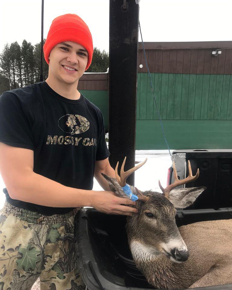 SHARP BROW TINES BUD—NMU junior political science major Jake Putala bags an 8-pointer with a 15-inch spread around 8:45 a.m. Monday, Nov. 18, in Baraga County. The buck weighed 132 pounds. Photo courtesy of Jake Putala