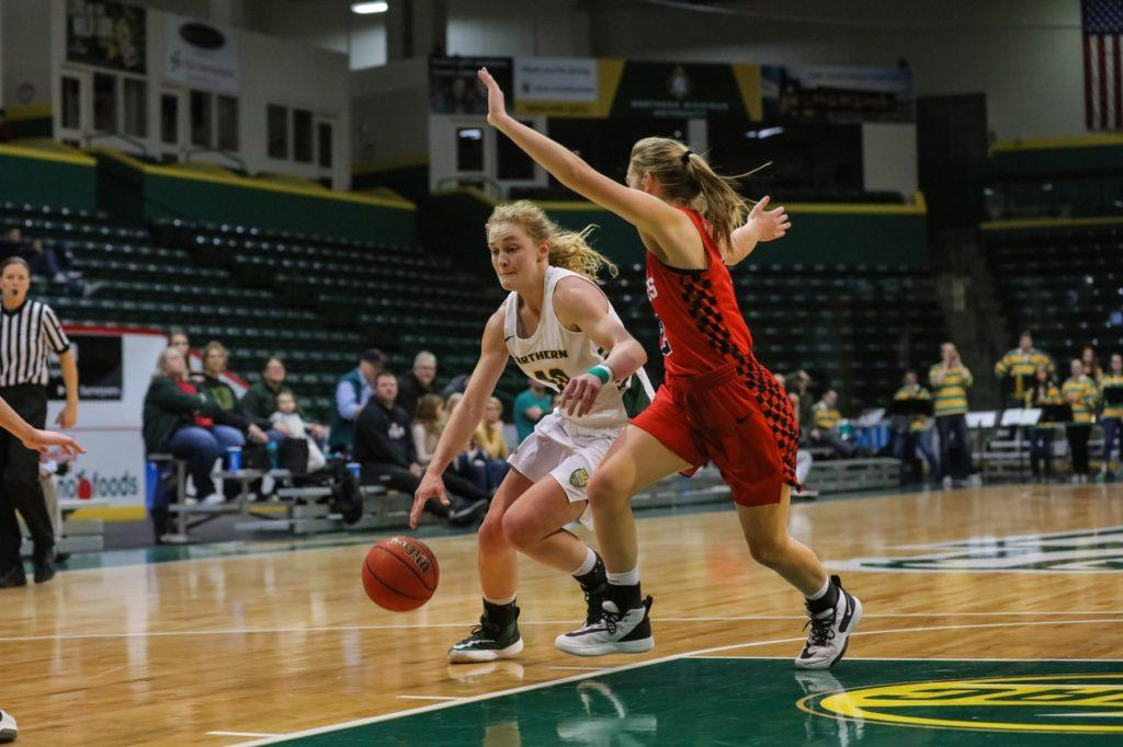 INJURIES HALTING WILDCATS—Junior guard Lexi Smith drives to the rim during NMU's 55-53 win over St. Cloud State University on Saturday, Nov. 23. Smith has been battling injury for a couple of weeks. Photo courtesy of NMU Athletics.