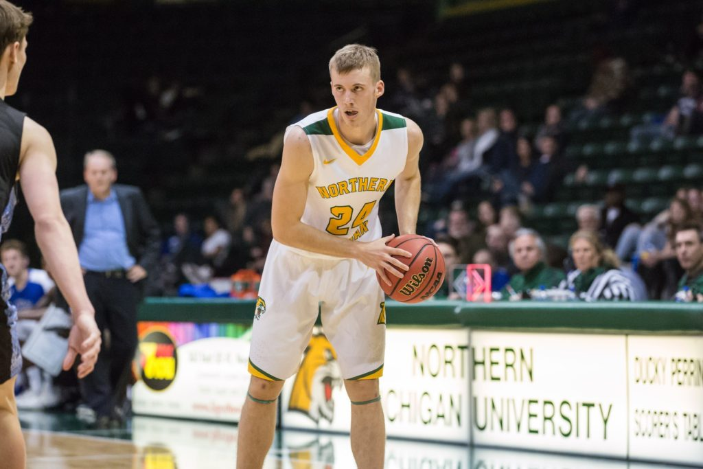 BACK AT HOME—Junior guard Alec Fruin possesses the ball in last season's 70-61 victory over Grand Valley State University on Saturday, Jan. 19. The Wildcats host Northwood University in its first GLIAC game this season. Photo courtesy of NMU Athletics.