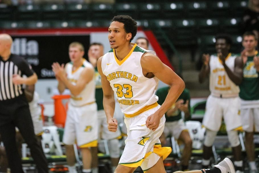 WINNING BIG—Senior forward Myles Howard leads the 'Cats with 14 points and 12 rebounds in a 67-58 road win over Davenport. Photo courtesy of NMU Athletics.