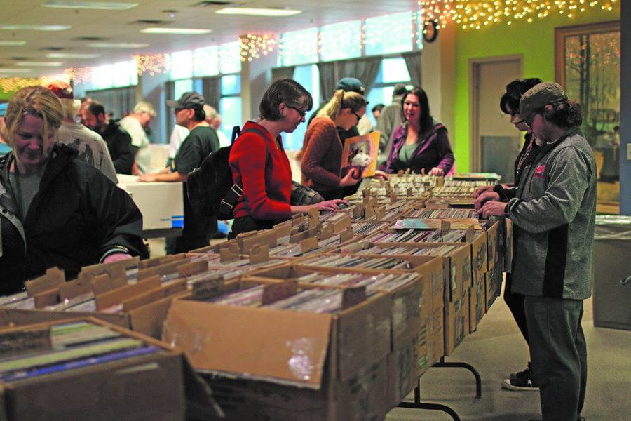 Photo  courtesy of Jon Teichman SWEET FINDS—Vinyl record enthusiasts rummage through cases on cases of every genre of music imaginable at a pervious vinyl record show. One mains trash is another mans treasure when it comes to vintage stock.