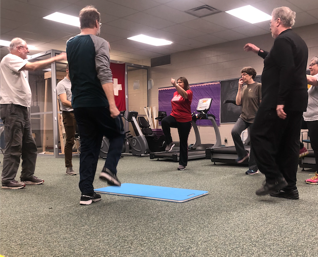 Maggie Duly/NW LOOSEN THOSE MUSCLES—A Graduate Teaching Assistant leads an active warm-up to begin the first low-intensity Move U.P. class meeting on Wednesday, Jan. 22 at the Physical Education Instruction Facility.