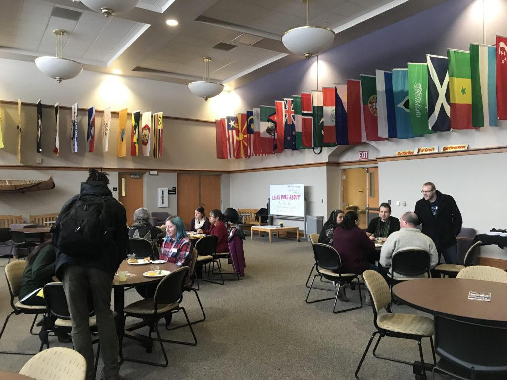 GATHER THE ROUND TABLE—McNair scholars and prospective members to the program gather to share and receive information in the Center for Native American Studies in Whitman Hall.