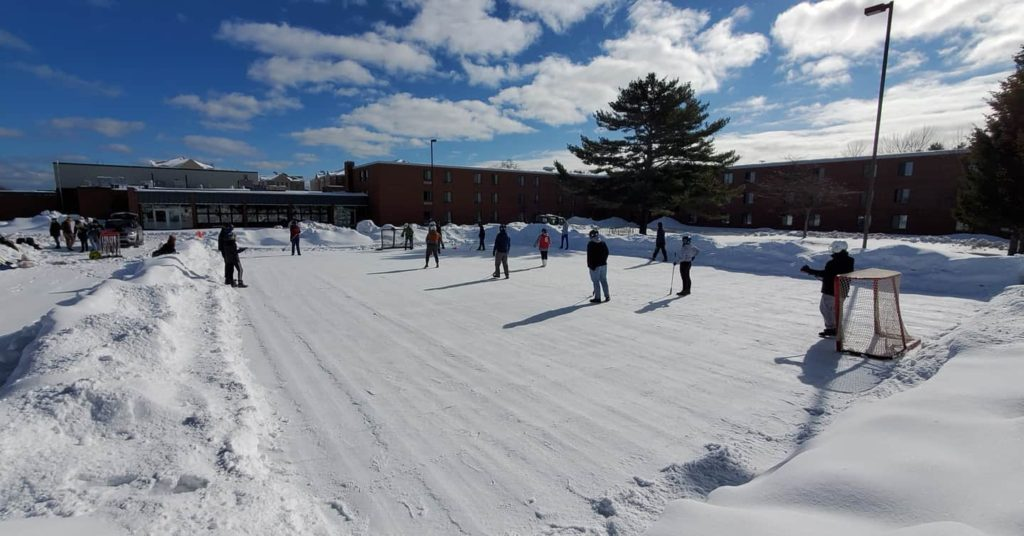 BRING OUT THE BROOMS—The new broomball rink near Spalding Hall is a hit on campus, especially during the warmest winter days. Photo courtesy of Christopher Smith.
