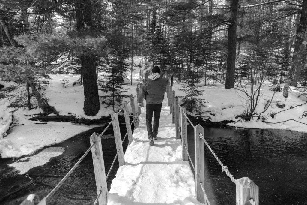 Rachel+Haggerty%2FNW%0ATRUDGING+THROUGH%E2%80%94Despite+the+frigid+temperatures%2C+NMU+alum+Anthony+Cilia+enjoys+a+hike+through+the+Little+Presque+Isle+Songbird+Trail+on+Tuesday%2C+Feb.+4+carefully+maneuvering+the+slippery+paths.+