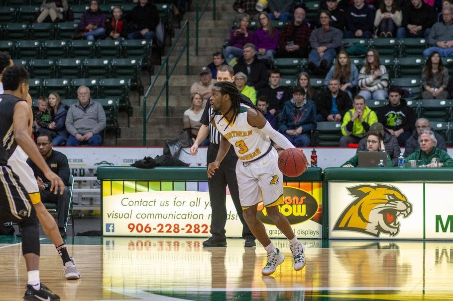 ON+THE+BUBBLE%E2%80%94As+of+today%2C+the+NMU+Men%E2%80%99s+Basketball+team+is+out+of+the+GLIAC+Tournament%2C+but+senior+guard+Sam+Taylor+looks+to+lead+the+%E2%80%98Cats+into+the+postseason.+Photo+courtesy+of+NMU+Athletics.