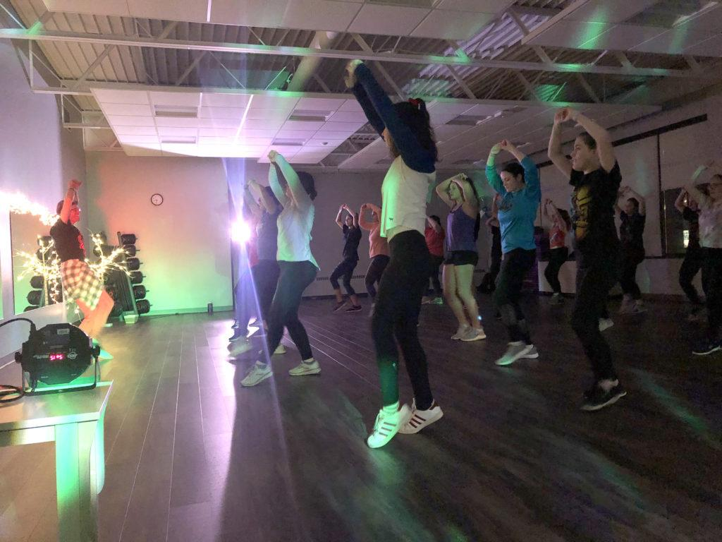 Maggie+Duly%2FNW%0AHIPS+DON%E2%80%99T+LIE%E2%80%94Multi-media+production+Professor+Mark+Shevy+%28left%29+leads+Zumba+class+in+the+NMU+Fit+Zone+packed+with+at+least+20+students+Tuesday%2C+Feb.+4.+The+class+followed+Shevy%E2%80%99s+handmade+Superbowl+half-time+show+inspired+playlist+including+old+and+new+music+from+Shakira+and+Jennifer+Lopez.+