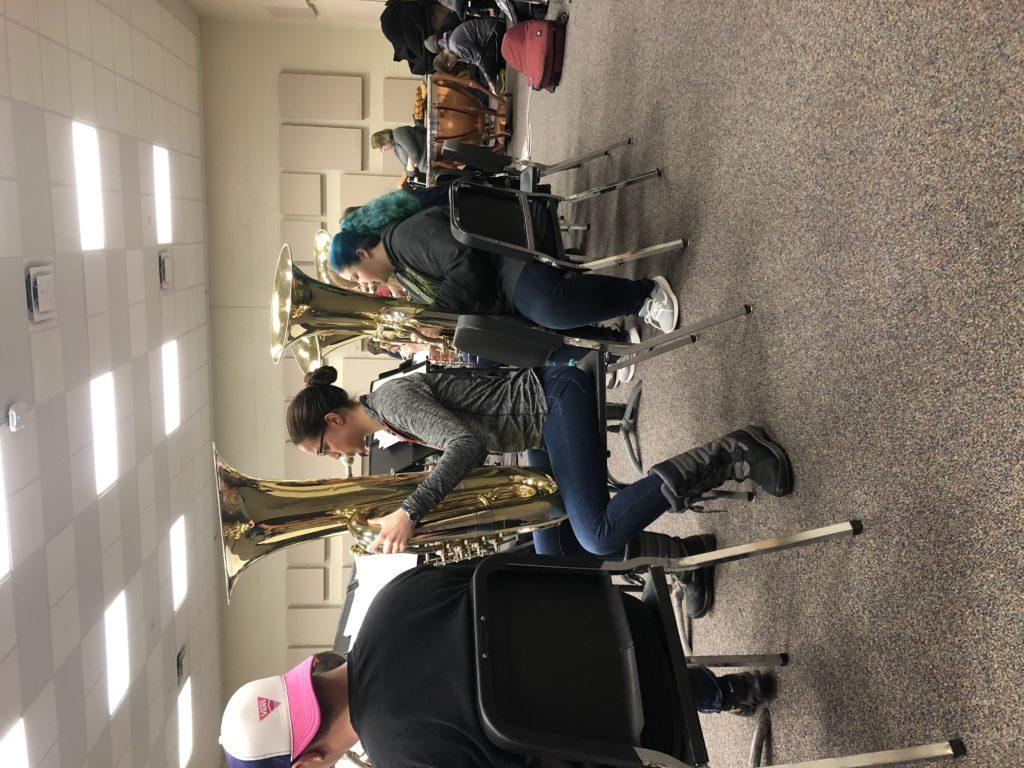 Maggie Duly/NW TAPPING ALONG—Junior biology major Madeline McDonald plays on que during one of the last rehearsals before the Symphonic Band and Wind Ensemble Concert on Monday, Feb. 24. The band practices for the concert in the Thomas Fine Arts building on Wednesday, Feb. 19.