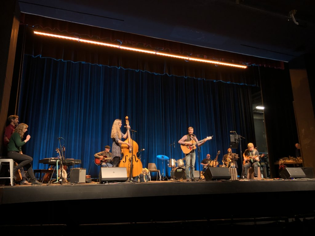 HOME GROWN—Local musicians Sarah Middlefehld and John Gillette strum along as they bring their set to the community during their performance at the Forest Roberts theater, on Saturday, Feb. 15.