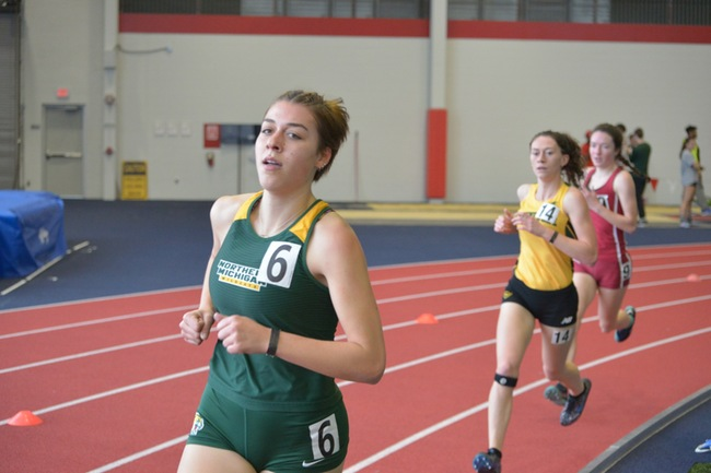 BIG TIME AT THE BIG DAWG—Sophomore Anna Kelley runs for the Wildcats with competitors right behind, and everyone was behind the Wildcats at the Big Dawg Invitational this past weekend. Photo courtesy of NMU Athletics.