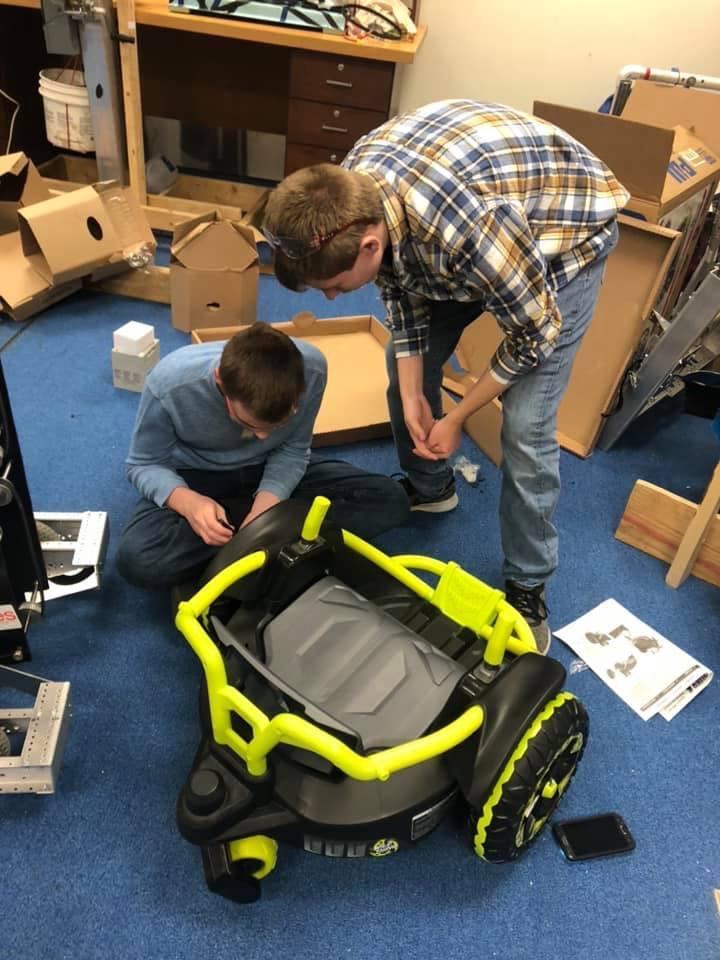 Photo courtesy of  Gobabygo MAC Facebook Page GETTING THE WHEELS TURNING—In preparation for their first vehicle modification coming up, Cold Logic  Robotics students, from Marquette High School, assemble the base of the vehicle on Wednesday, March 11.