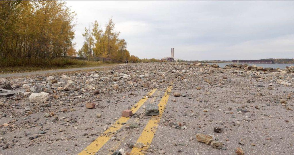 Micah Munts ON THE ROCKS—Lakeshore Boulevard is covered in rocks caused by the rising water levels pushing them onto the road. Initiatives to move the highway an additional 500 ft has been discussed by city officials but a decision has yet to be reached.