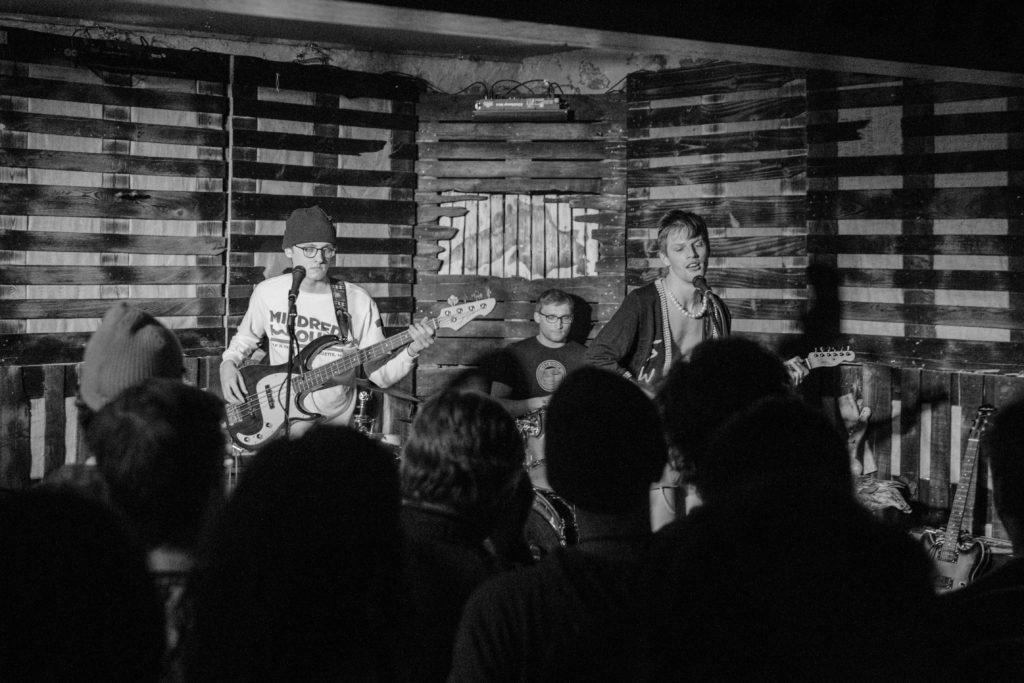 Photo+by+Rachel+Haggerty%0ACROWD+PLEASER+%28left%29%E2%80%94Shipwreck+Kelly+performs+their+song+%E2%80%9CAlone+%E2%80%9CTogether%E2%80%9D+with+bassist+Wyatt+Furois+%28left%29%2C+drummer+Billy+Scott+and+front+man+Sam+Miess.++The+trio+debuted+their+first+album+at+the+Ore+Dock+Brewing+Co.+on+March+15.+