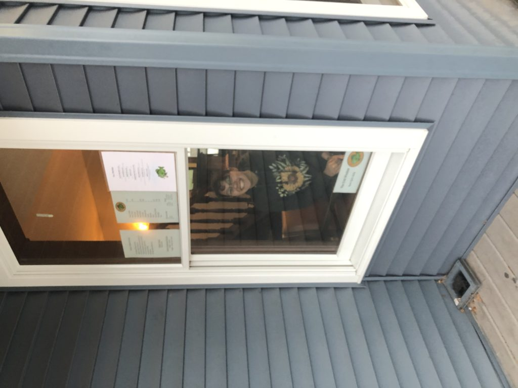 Photo courtesy of Emily Wegemer FREE SMILES—One of The Crib's baristas, junior political science major  Sarah Saead, works the walk-through window to promote social distancing.