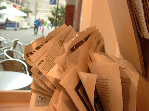 newspapers in a cafe