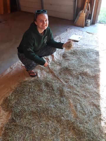 Erin Matula posing over harvested rice