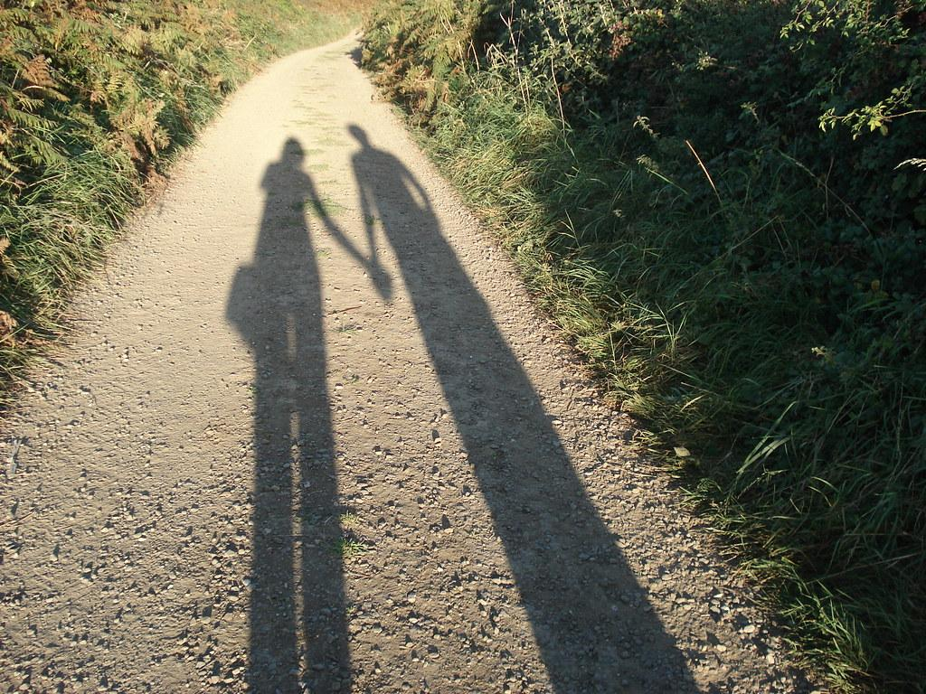 Two shadows holding hands