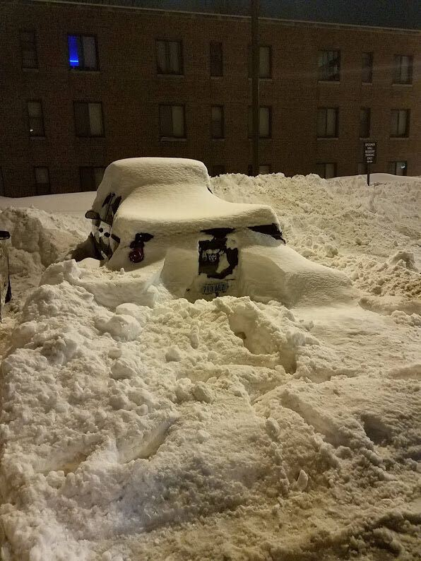 Photo of a vehicle buried in snow