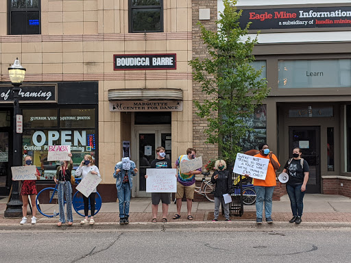 NO JUSTICE NO PEACE: Black Lives Matter protesters stand across from the Marquette County Field Office of the Michigan Republican Party to demand police reform and an end to racial inequality. Left to right: Camry Todd, Brianna Powell, Hannah Powell, Simeon Higgins, Jax Andrés, Ben Prickle, Josie Steed, Fred Sims, Sarah Skinner. Katarina Rothhorn/NW