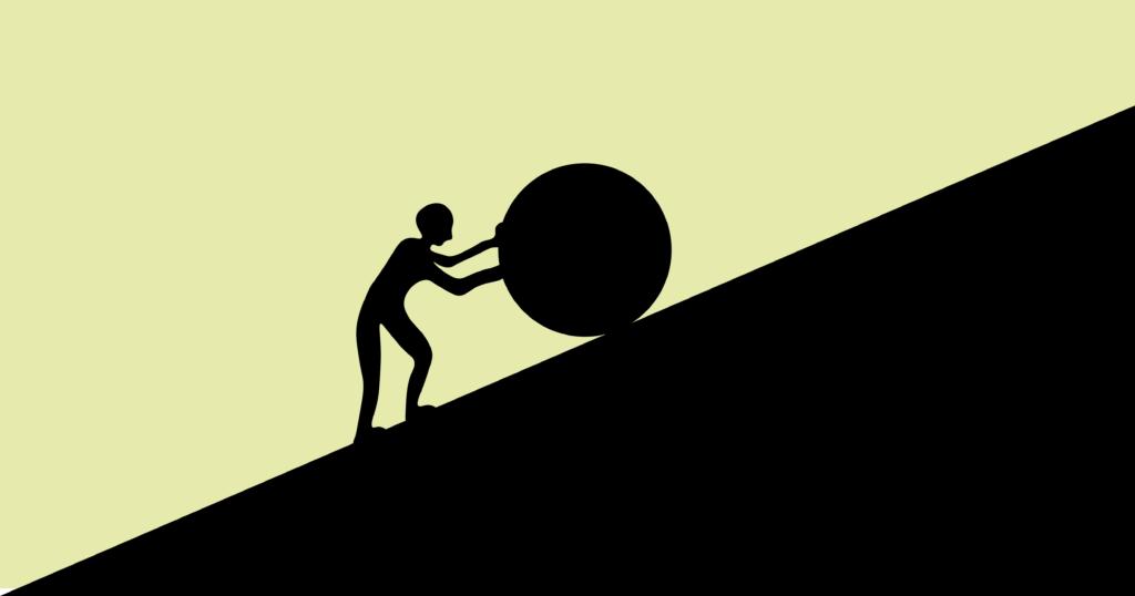 Man+pushes+a+boulder+up+a+slope