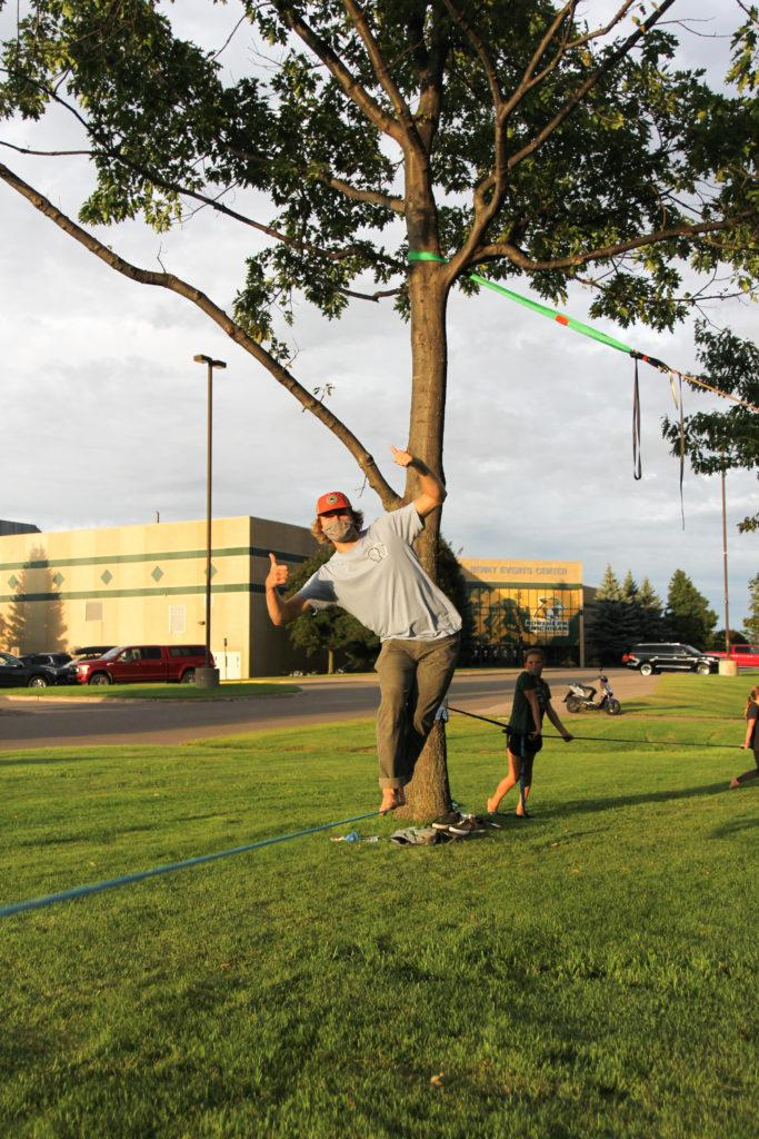 Photo courtesy of Micah Carroll WALK DOWN THE LINE—Each week outside of the Berry Events Center, you'll find the South Superior Climbing Club's slacklining group. For beginners to experts, slacklining is available for everyone.