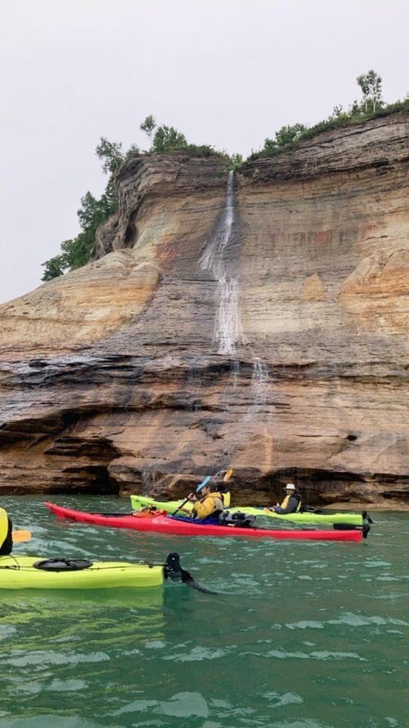 Maggie Duly/NW FUN IN THE SUN—The Uncle Ducky's/Paddling Michigan kayak tour staff, filled with many NMU students, go out on Lake Superior each day to show visitors the incredible scenery that Pictured Rocks National Lakeshore has to offer.