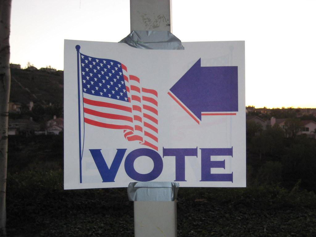 sign directing voters to the polls