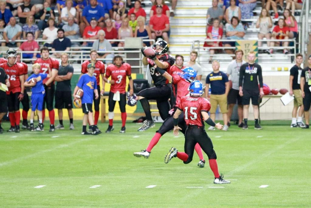 FAMILIAR TERRITORY—Jake Witt mightve played basketball at Michigan Tech, but he has experience in the Superior Dome with this catch in the 2018 U.P. High School Football All-Star Game. Witt looks to provide more where that came from by joining the Wildcats football team. Photo courtesy of Jake Witt.