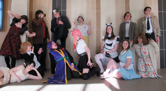 Photo of cosplayers posing in costume