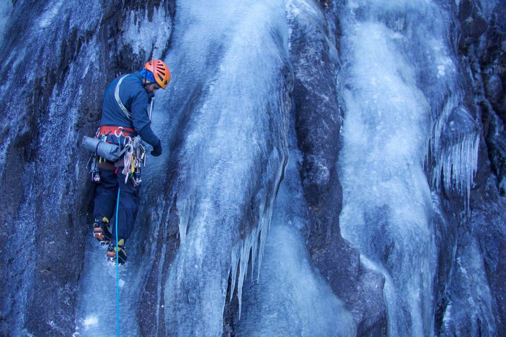 Photo courtesy of Paul Mcsorley PRO CLIMBING— An ice climber takes a breath during an ice climb in Munising, Michigan. January through March are typically the best times to ice climb in the U.P.