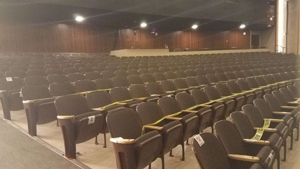 Photo of NMU theatre with seats marked off with caution tape