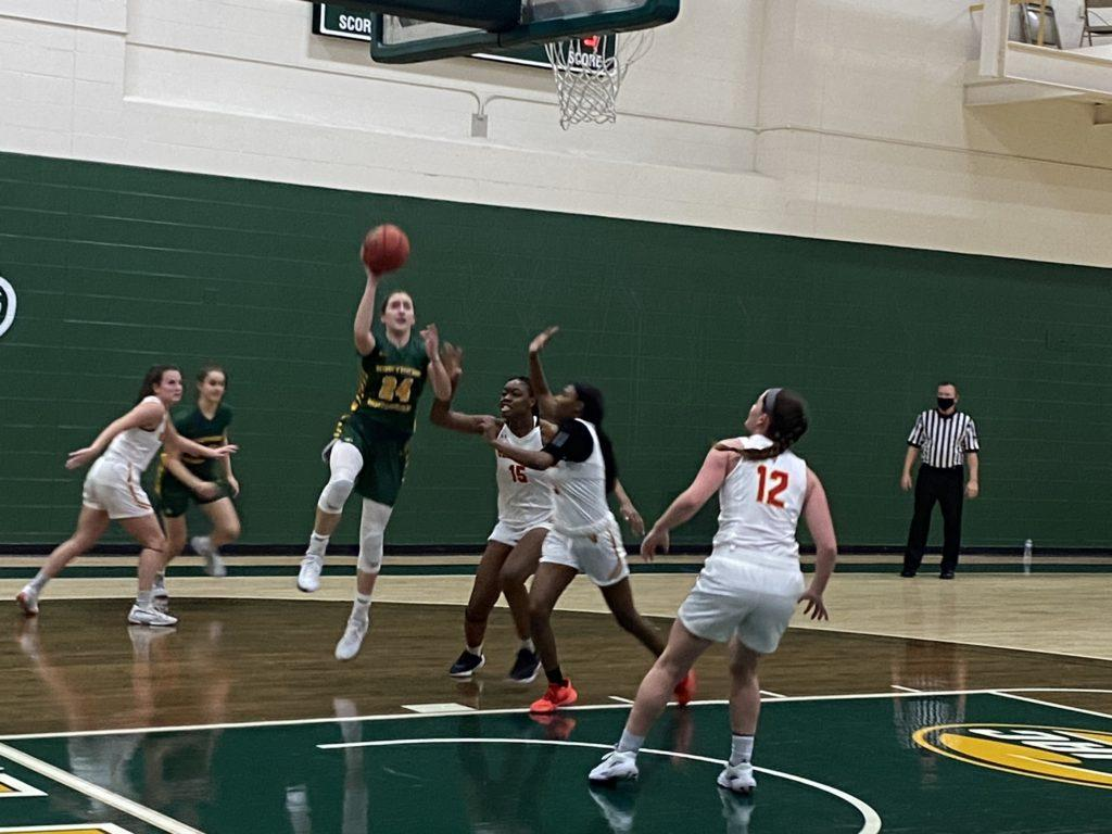 CLAWING FOR CONTENTION—The NMU Womens Basketball team travels across the bridge to Midland to face Northwood in a crucial series between two 6-3 teams. Travis Nelson/NW