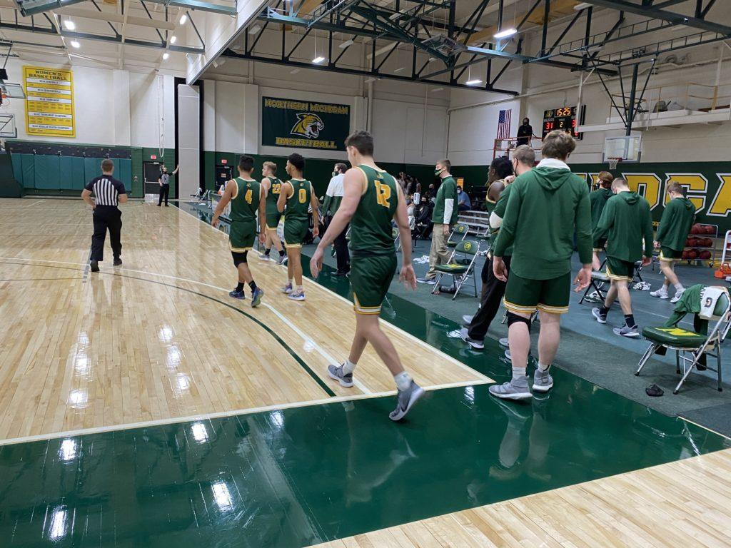 TOURNEY ASPIRATIONS—The NMU Mens Basketball team looks to have another successful series like this past weekend against Davenport. Travis Nelson/NW