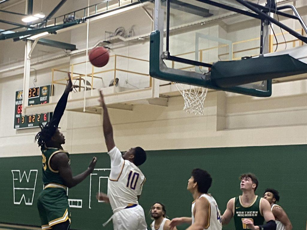 NMU FLAME THROWERS—The NMU Mens Basketball shot 51.6% from the field in a dominant 91-70 win over Lake Superior State on Sunday afternoon. Travis Nelson/NW