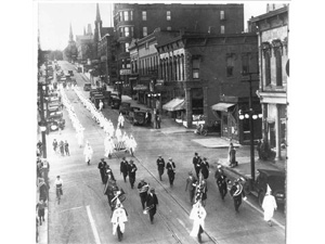 Photo courtesy of NMU archives. PRIMARY SOURCES-The archives collaborated with the diversity common reader program in 2017 and presented a 1926 image of a Ku Klux Klan parade in downtown Marquette.