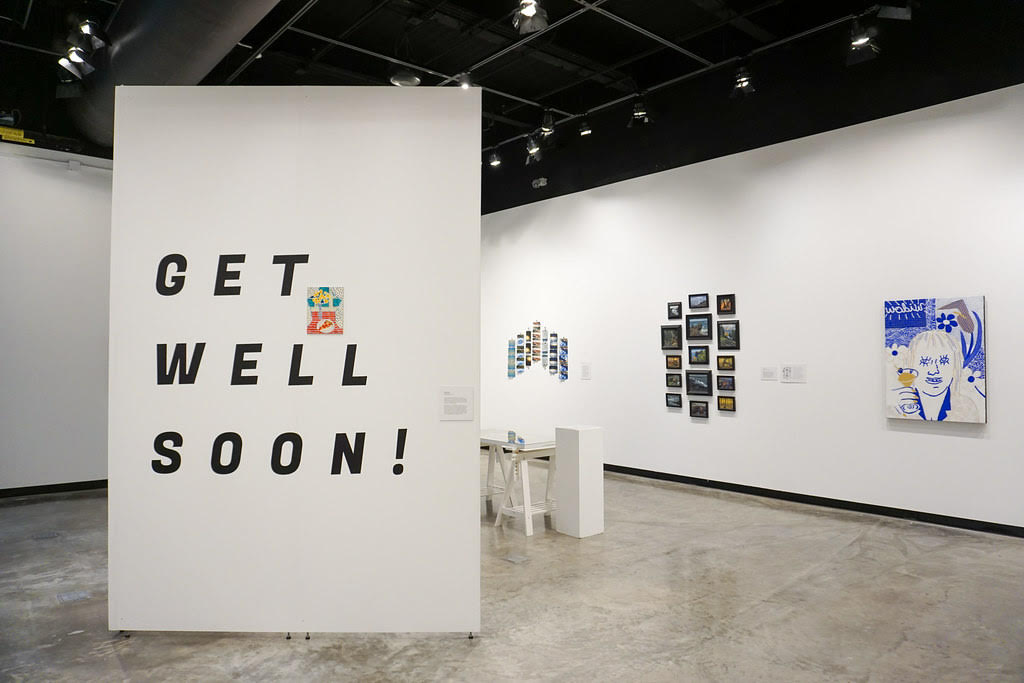 Photo+courtesy+of+Lily+Lindgren%0A%0AGET+WELL+SOON+-+As+part+of+the+Faculty+Biennial+Exhibition%2C+Emily+Lanctot+presented+her+piece+titled+%22Get+Well+Soon%22+presenting+ways+to+get+well+during+these+trying+times.