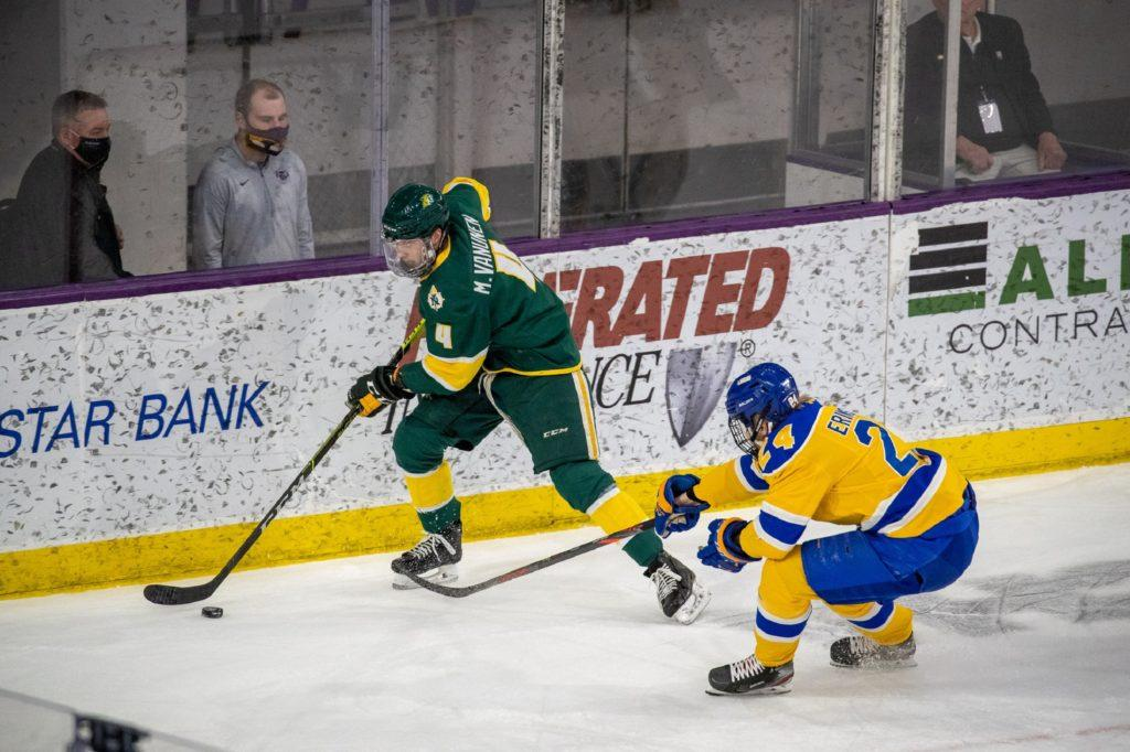 CATS FINISH AS RUNNER UP—NMU sophomore defenseman Michael Van Unen attempts to skate away from an LSSU Laker during Saturdays WCHA Championship game. The Wildcats lost 6-3, ending their with an 11-17-1 record. Northern defeated two high-quality opponents in Bowling Green and Mankato to reach the finals, but the Cats came up short. Photo courtesy of NMU Athletics.